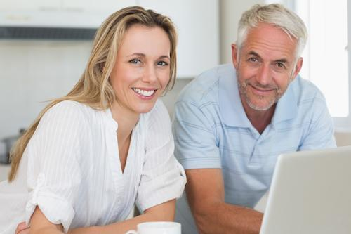 Couple at Computer | Dental Crowns Fairfield NSW